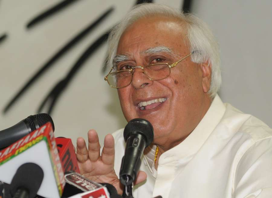 Union Law Minister and Congress leader Kapil Sibal addresses a press conference at AICC office in New Delhi on May 6, 2014. (Photo: IANS) by .