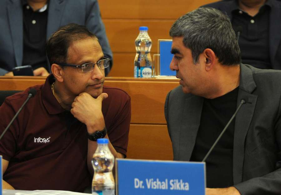 Bengaluru: Infosys CEO Vishal Sikka and COO Pravin Rao during a press conference to announce the company's 2nd quarter financial results in Bengaluru on Oct 14, 2016. (Photo: IANS) by .