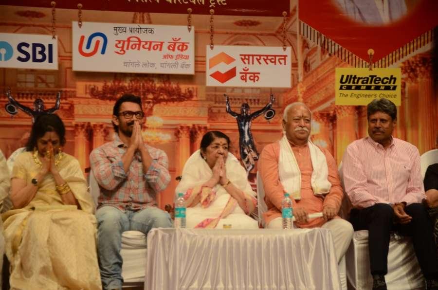 Mumbai: Actors Aamir Khan and Vyjayanthimala, singer Lata Mangeshkar, former cricketer Kapil Dev, RSS chief Mohan Bhagwat and others during Dinanath Mangeshkar memorial awards in Mumbai, on April 24, 2017. (Photo: IANS) by .