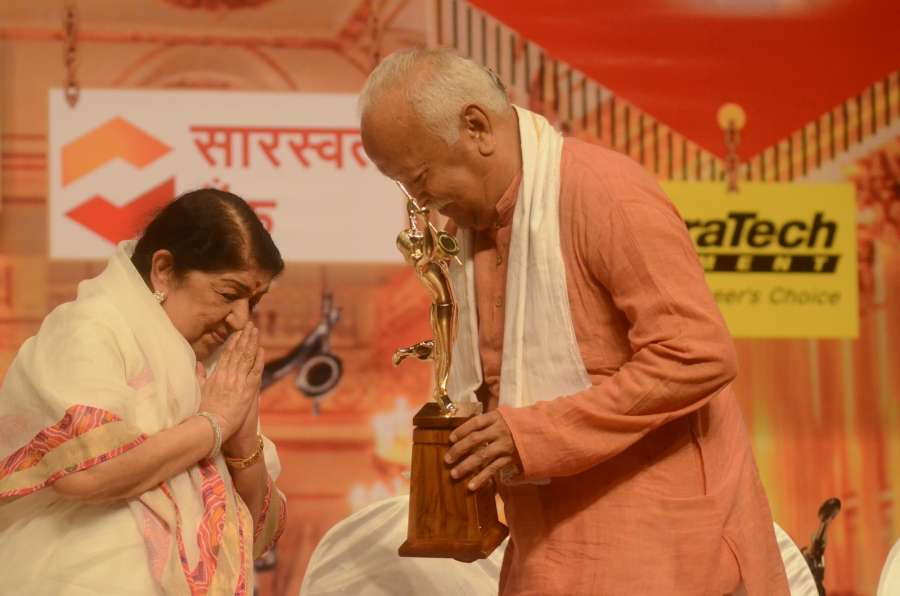 Mumbai: Singer Lata Mangeshkar being felicitated by RSS chief Mohan Bhagwat during Dinanath Mangeshkar memorial awards in Mumbai, on April 24, 2017. (Photo: IANS) by .