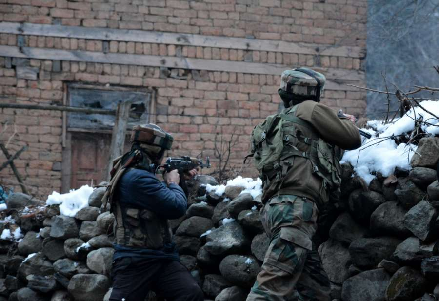 Anantnag: Soldiers in action during a gunfight with militants in Jammu and Kashmir's Anantnag district on Jan 15, 2017. (Photo: IANS) by .
