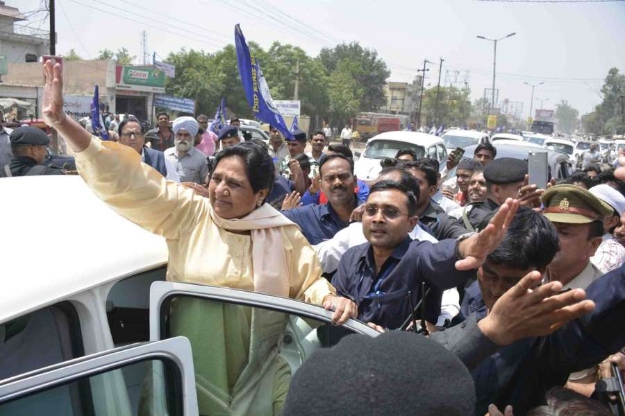 Ghaziabad: BSP chief Mayawati waves at her supporters in Ghaziabad on May 23, 2017. (Photo:IANS) by .