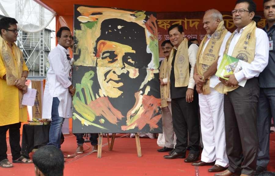 Guwahati: Assam Chief Minister Sarbananda Sonowal pays tribute to legendary singer Bhupen Hazarika on his death anniversary in Guwahati on Nov 5, 2016. (Photo: IANS) by .