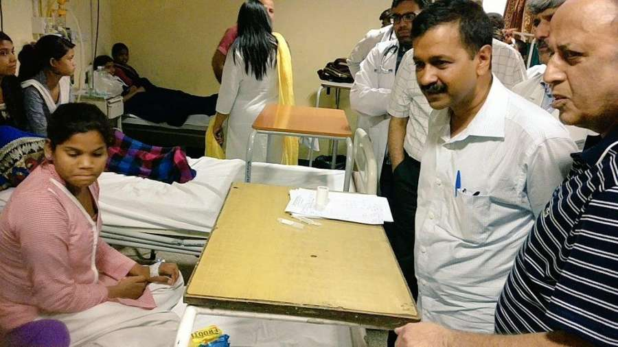 New Delhi: Delhi Chief Minister Arvind Kejriwal talks to the students who fell ill due to gas leak near the school in New Delhi on May 6, 2017. Over 300 students of two girls schools were rushed to hospital on Saturday morning after they complained of dizziness and headache following gas leak from a chemical container near their schools in south Delhi, police said. (Photo: IANS) by .