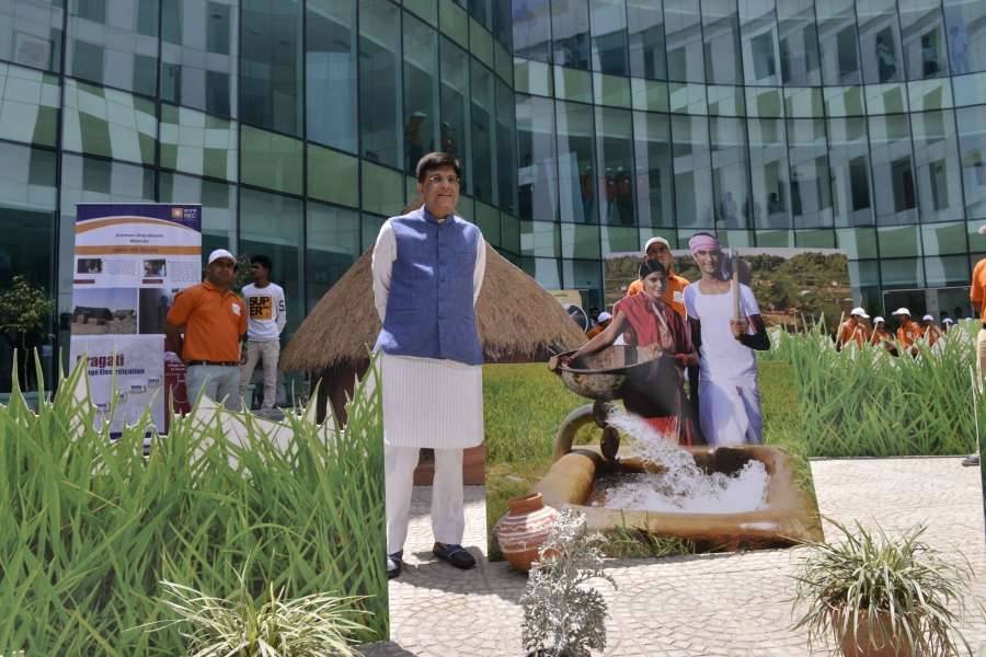 New Delhi: Union Minister of State for Power, Coal, New & Renewable Energy & Mines, Piyush Goyal looks at an artificial village created before the start of press conference on Deendayal Upadhyaya Gram Jyoti Yojana- Rural Electrification Scheme in New Delhi on May 19, 2017. (Photo: IANS) by .