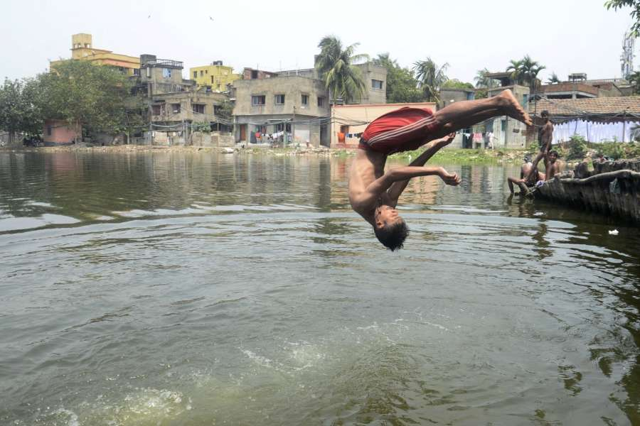Kolkata: A boy plunges into a pond to beat the heat on a hot day in Kolkata on May 21, 2017. (Photo: Kuntal Chakrabarty/IANS) by .