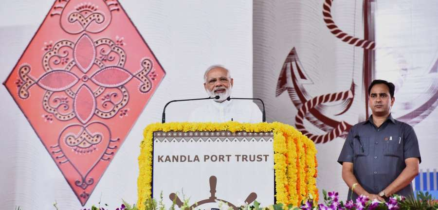 Gandhidham: Prime Minister Narendra Modi addresses at the foundation stone laying ceremony of various developmental projects of Kandla Port, in Gandhidham, Gujarat on May 22, 2017. (Photo: IANS/PIB) by .