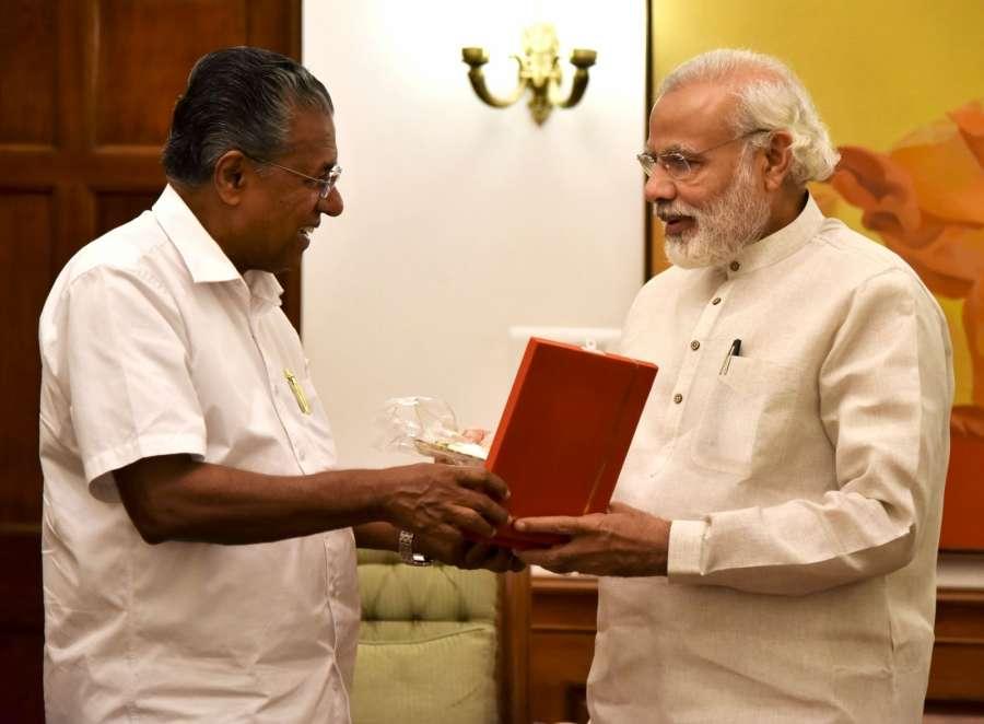 New Delhi: Kerala Chief Minister Pinarayi Vijayan calls on the Prime Minister Narendra Modi, in New Delhi, on May 28, 2016. (Photo: IANS/PIB) by .
