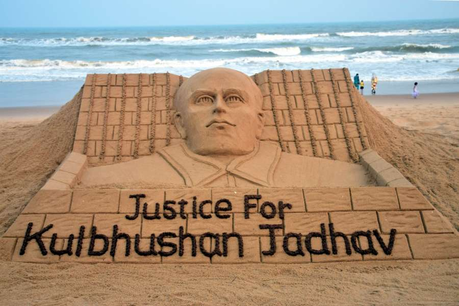 "Puri: Renowned sand artist Sudarsan Pattnaik's creation to press for ""Justice for Kulbhushan Jadhav"" in Puri on May 15, 2017. (Photo: IANS) by ."
