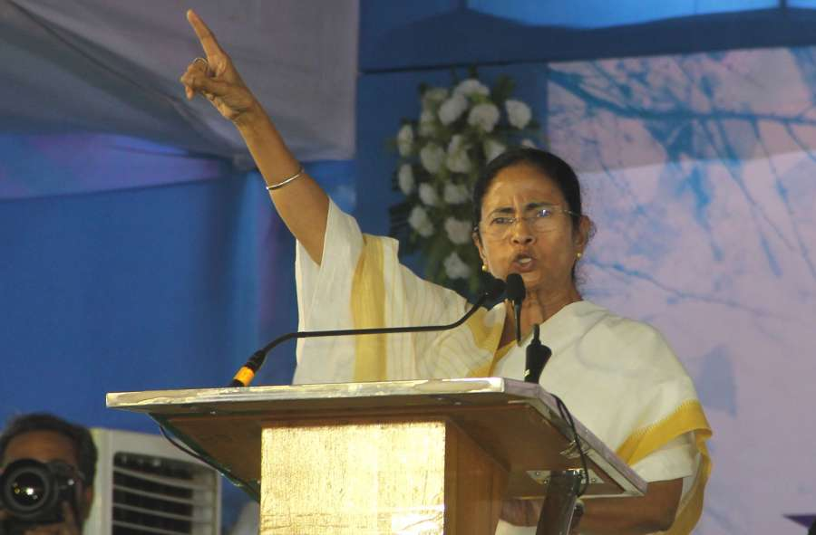 Malda: West Bengal Chief Minister Mamata Banerjee addresses during a programme in Malda on May 4, 2017. (Photo: IANS) by .