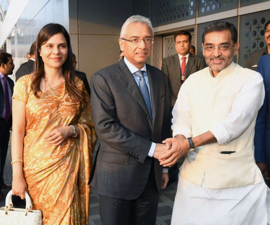 New Delhi: Mauritian Prime Minister Pravind Kumar Jugnauth and Kobita Ramdanee-Jugnauth being received by the Union MoS HRD Upendra Kushwaha, on their arrival at IGI Airport, in New Delhi on May 26, 2017. (Photo: IANS/PIB) by .