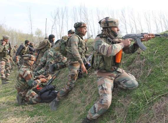 Pulwama: Security personnel during an encounter with militants in Pulwama district of Jammu and Kashmir on March 5, 2017. One policeman and two militants were killed in a gunfight that lasted over 15 hours. (Photo: IANS) by .