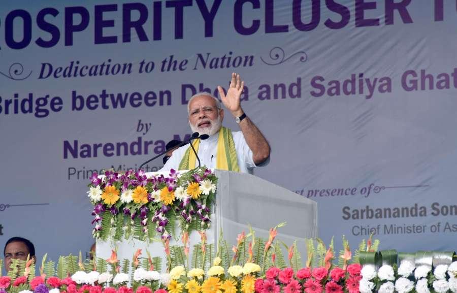 Assam: Prime Minister Narendra Modi addresses a public meeting after inaugurating Dhola-Sadia Bridge across Brahmaputra river, in Assam's Dibrugarh on May 26, 2017. (Photo: IANS/PIB) by .