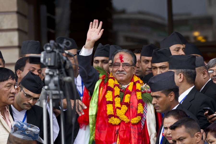 KATHMANDU, Aug. 3, 2016 (Xinhua) -- Nepal's newly elected Prime Minister Puspa Kamal Dahal (C) waves after winning the election in Kathmandu, Nepal, Aug. 3, 2016. CPN (Maoist Center) Chairman Pushpa Kamal Dahal, also known as Prachanda, is elected as the 39th Prime Minister of Nepal on Wednesday. (Xinhua/Pratap Thapa/IANS) by .