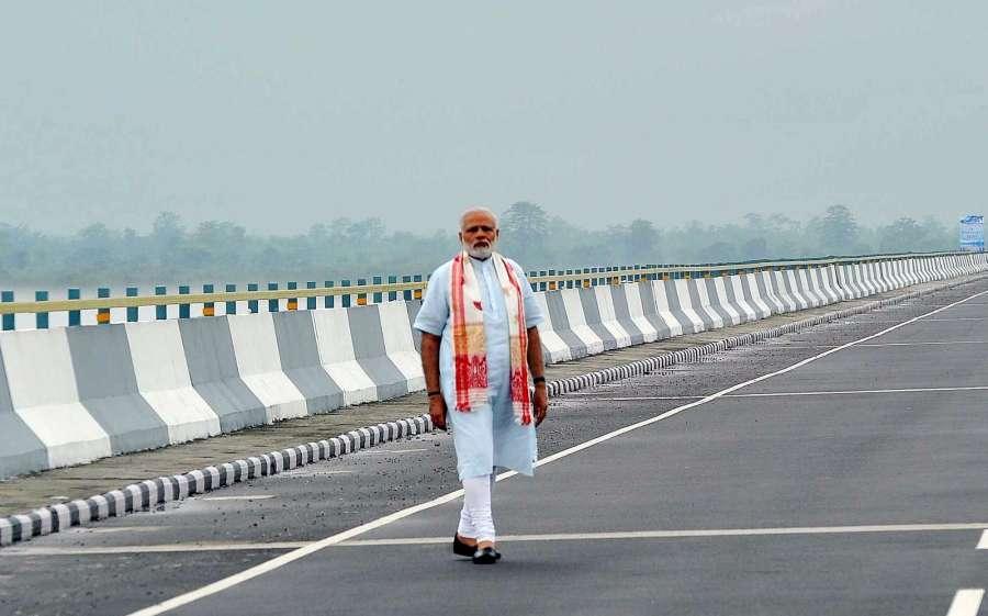 Assam: Prime Minister Narendra Modi at Dhola-Sadia Bridge across River Brahmaputra, in Assam on May 26, 2017. (Photo: IANS/PIB) by .