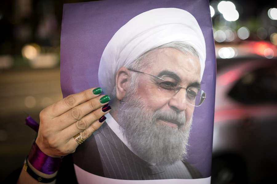 TEHRAN, May 18, 2017 (Xinhua) -- A supporter holds a poster of Iranian President and presidential candidate Hassan Rouhani during a street campaign in Tehran, Iran, May 18, 2017. Iran's 12th presidential election is scheduled for May 19. (Xinhua/Ahmad Halabisaz/IANS) by .