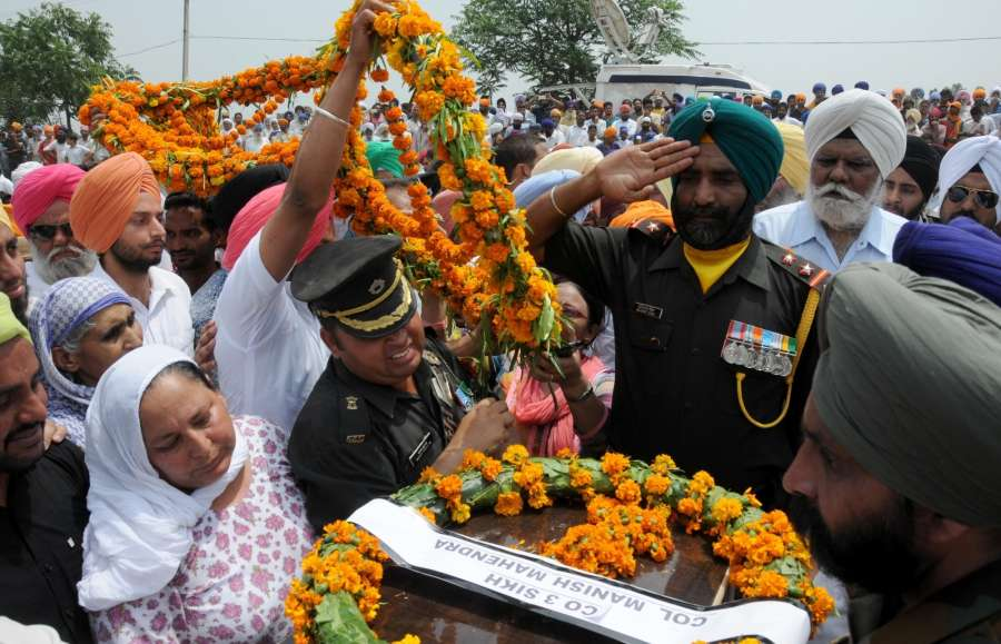Vain Poin: Funeral of Naib Subedar Paramjit Singh one of the two Indian soldiers whose body was mutilated along the Line of Control on 1st May, 2017 underway at village Vain Poin, some 40 km away from Amritsar on May 2, 2017. (Photo: IANS) by .