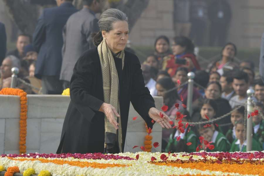 New Delhi: Congress chief Sonia Gandhi pays tributes at the Samadhi of Mahatma Gandhi on the occasion of Martyr's Day at Rajghat, in Delhi, on Jan 30, 2017. (Photo: IANS) by .