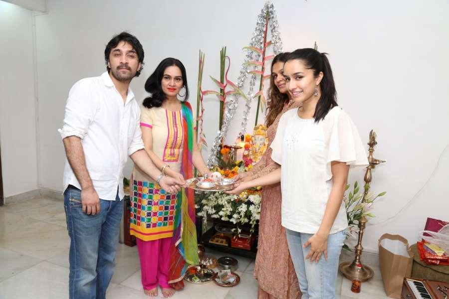 Mumbai: Actress Shraddha Kapoor along with her brother Siddhanth Kapoor, aunts and actors Padmini Kolhapure and Tejaswini Kolhapure during the Ganesh Chaturthi celebrations in Mumbai, on Sept. 5, 2016. (Photo:IANS) by .