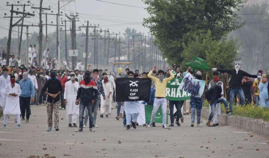Srinagar: Clashes between security forces and protesters broke out on the occasion of Eid-ul-Fitr in Srinagar on June 26, 2017. (Photo: IANS) by .