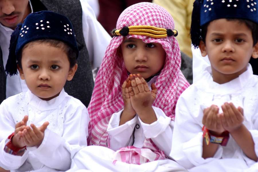 Bengaluru: Children offer prayers on the occasion of Eid-ul-Fitr at Idga Maidan in Bengaluru on June 26, 2017. (Photo: IANS) by .