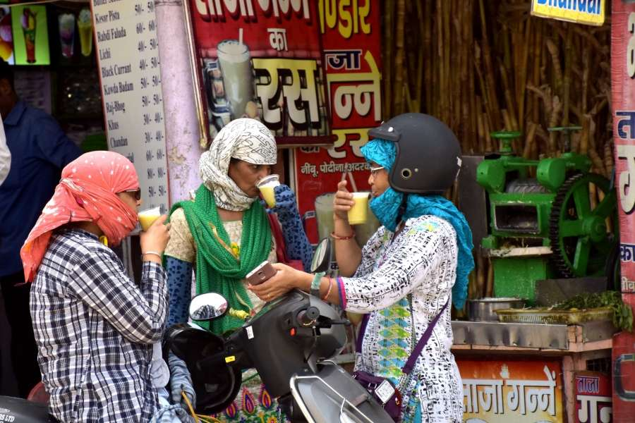Jaipur: Women sip sugarcane juice to beat the heat in Jaipur, on May 27, 2017. (Photo: Ravi Shankar Vyas/IANS) by .