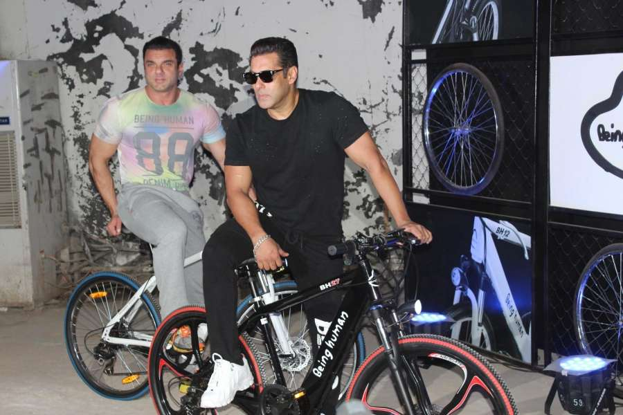 Mumbai: Actors Salman Khan and Arbaaz Khan during the launch of Being Human electric bicycles in Mumbai on June 5, 2017. (Photo: IANS) by .