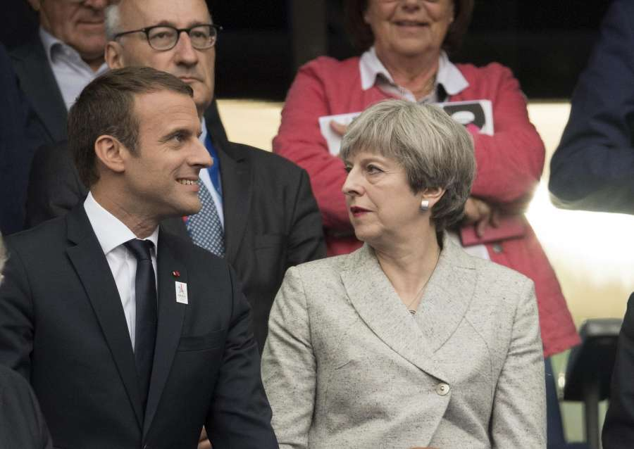 SAINT-DENIS, June 14, 2017 (Xinhua) -- French President Emmanuel Macron (L) and British Prime Minister Theresa May attend the international friendly match between France and England at the Stade de France in Saint-Denis, France on June 13, 2017. France won England with 3-2. (Xinhua/David Niviere/IANS) by .