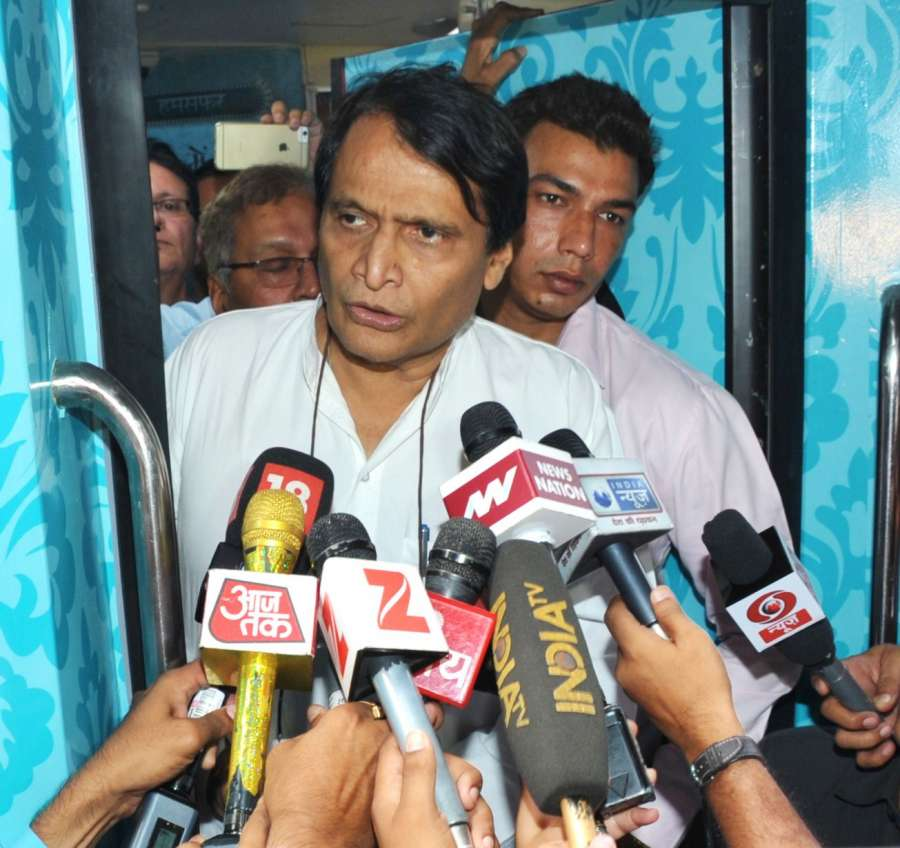 New Delhi: Union Minister for Railways Suresh Prabhu interacts with the media after inspecting the rake of Humsafar Train with added features at Safdarjung Railway Station in New Delhi on June 14, 2017. (Photo: IANS/PIB) by .
