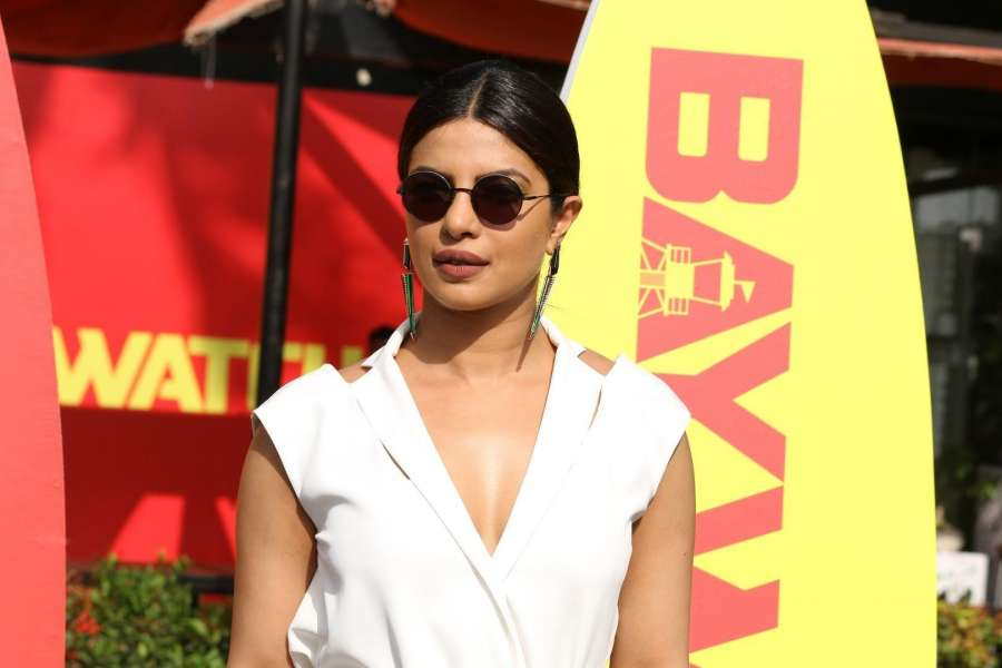 """Caption : Mumbai: Actress Priyanka Chopra during a programme organised to promote of her upcoming Hollywood film """"Baywatch"""" in Mumbai on April 26, 2017. She will be seen playing a negative role in the film.(Photo: IANS) by ."""