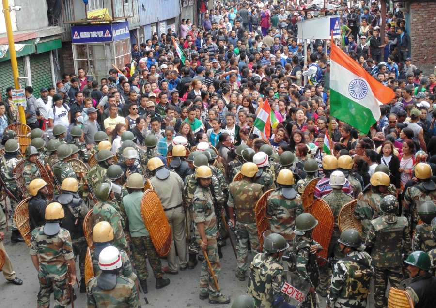 Darjeeling: Gorkha Janmukti Morcha (GJM) supporters clashed with police during a Gorkha Janamukti Morcha (GJM) indefinite shutdown in the northern Bengal hills; in Darjeeling on June 17, 2017. (Photo: IANS) by .