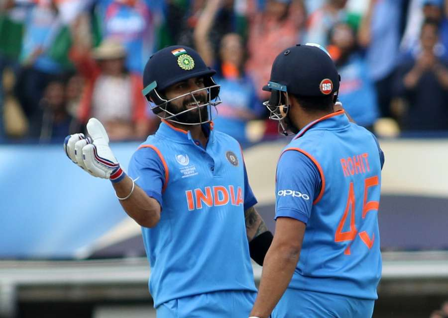 Birmingham: Indian captain Virat Kohli celebrates with teammate Rohit Sharma after winning the second semi-final match of ICC Champions Trophy between India and Bangladesh at Edgbaston in Birmingham, Britain on June 15, 2017. (Photo: Surjeet Yadav/IANS) by .