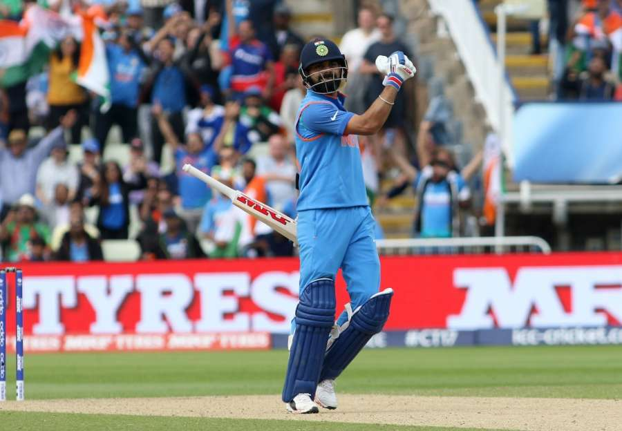 Indian captain Virat Kohli celebrates after winning the second semi-final match of ICC Champions Trophy between India and Bangladesh at Edgbaston in Birmingham, Britain on June 15, 2017. (Photo: Surjeet Yadav/IANS) by .