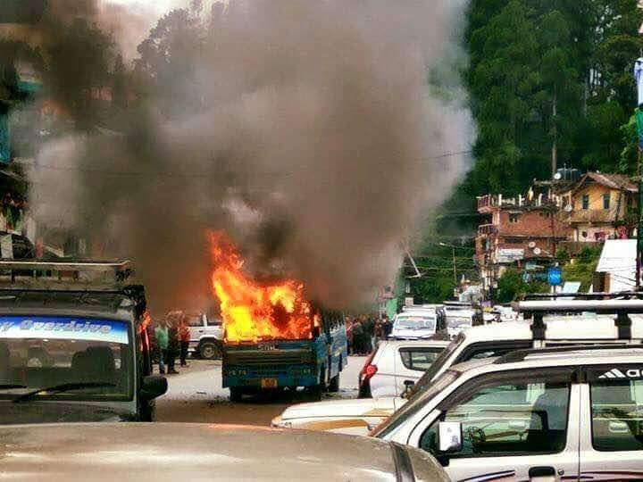 Darjeeling: A bus that was torched by Gorkha Janmukti Morcha (GJM) activists during a demonstration in Darjeeling on June 8, 2017. (Photo: IANS) by .