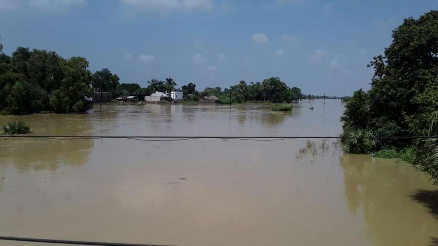 Bardhaman: A view of flood hit Bardhaman district in West Bengal, on Aug 23, 2016. (Photo: IANS) by .