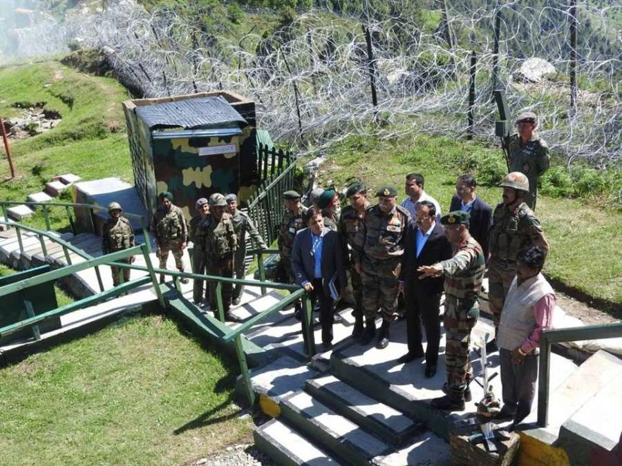 Kashmir: Union MoS Defence Dr. Subhash Bhamre during his visit to forward areas along the Line of Control in Jammu and Kashmir on June 9, 2017. (Photo: IANS) by .
