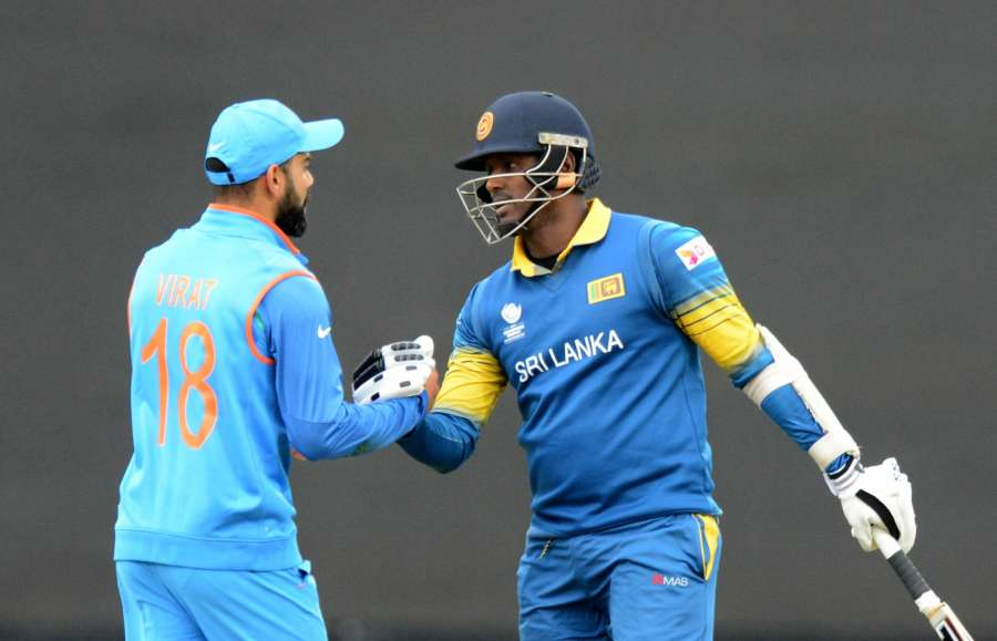 London: Indian cricket captain Virat Kohli greets his Sri Lankan counterpart Angelo Mathews after Sri Lanka won the ICC Champions Trophy, Group B match against India at Kennington Oval, London, UK on June 8, 2017. (Photo: Bipin Patel/IANS) by .