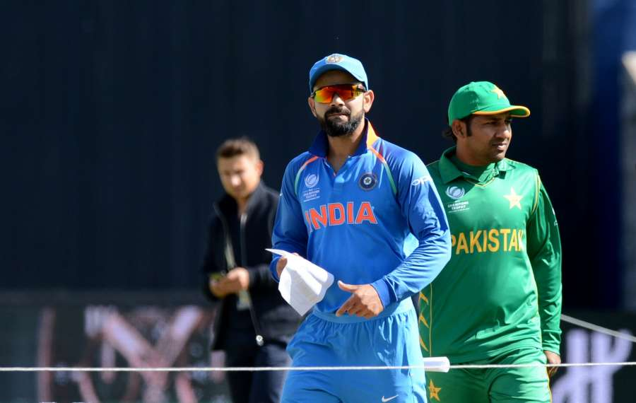 Birmingham: Indian captain Virat Kohli and his Pakistani Counterpart Sarfraz Ahmed during the toss for the ICC Champions Trophy, Group B match between India and Pakistan at Edgbaston, Birmingham, UK on June 4, 2017. (Photo: Bipin Patel/IANS) by .
