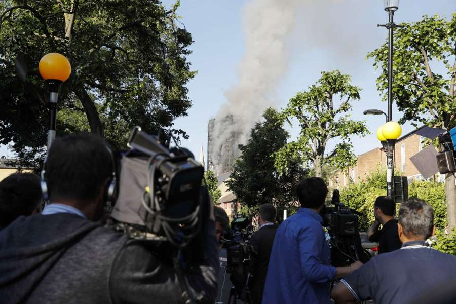 LONDON, June 14, 2017 (Xinhua) -- Media staff work near an apartment building which is engulfed by a massive fire in western London, Britain, June 14, 2017. A massive fire engulfed a 27-story apartment building in western London early Wednesday three hours after police received the first report of the blaze. (Xinhua/Han Yan/IANS) by .