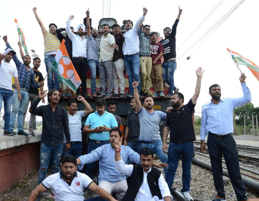 Jammu: Youth Congress activists disrupt railway services in Jammu against killing of five farmers in Madhya Pradesh's Mandsaur district on June 8, 2017. (Photo: IANS) by .