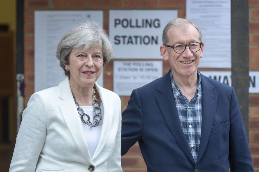 SONNING (BRITAIN), June 8, 2017 (Xinhua) -- Britain's Prime Minister and leader of the Conservative Party Theresa May (L) and her husband walk out from the polling station after casting their ballots for the general election in Sonning, Britain on June 8, 2017. (Xinhua/Tim Ireland/IANS) (lrz) by .