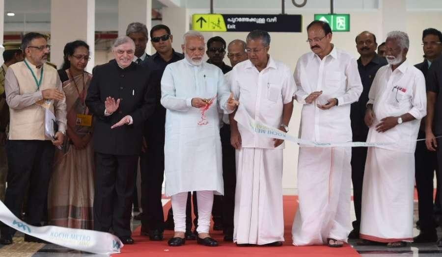 Kochi: Prime Minister Narendra Modi inaugurates the Kochi Metro, in Kerala on June 17, 2017. The Governor of Kerala, Justice (Retd.) P. Sathasivam, the Union Minister for Urban Development, Housing & Urban Poverty Alleviation and Information & Broadcasting, M. Venkaiah Naidu, the Chief Minister of Kerala Pinarayi Vijayan and the Secretary, Ministry of Urban Development Rajiv Gauba are also seen. (Photo: IANS/PIB) by .