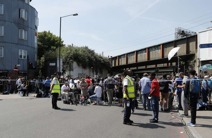 "LONDON, June 19, 2017 (Xinhua) -- Large amount of media gather outside the police cordon where a van ran into worshippers near a north London mosque, Britain, June 19, 2017. At least one was killed and 10 others were injured when a van was driven into worshippers early morning on Monday near a north London mosque in what police have called a ""major incident."" (Xinhua/Han Yan/IANS) by ."
