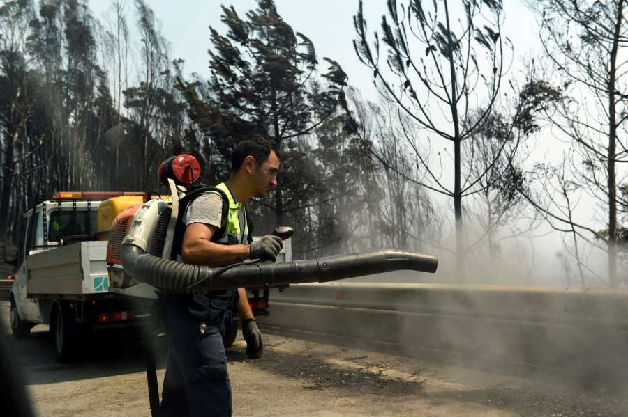 LISBON, June 18, 2017 (Xinhua) -- A staff worker cleans up the site of forest fire in the area of Pedrogao Grande, central Portugal on June 18, 2017. The number of people killed in the forest fire raging in central Portugal has risen to 62, with 54 others injured, State Secretary of Internal Affairs Ministry Jorge Gomes said Sunday. The fire broke out Saturday in Pedrogao Grande, northeast of Lisbon, and quickly spread to the towns of Figueird dos Vinhos and Castanheira de Pera in the district of Leiria, where firefighters are still battling the fire. (Xinhua/Zhang Liyun/IANS) by .