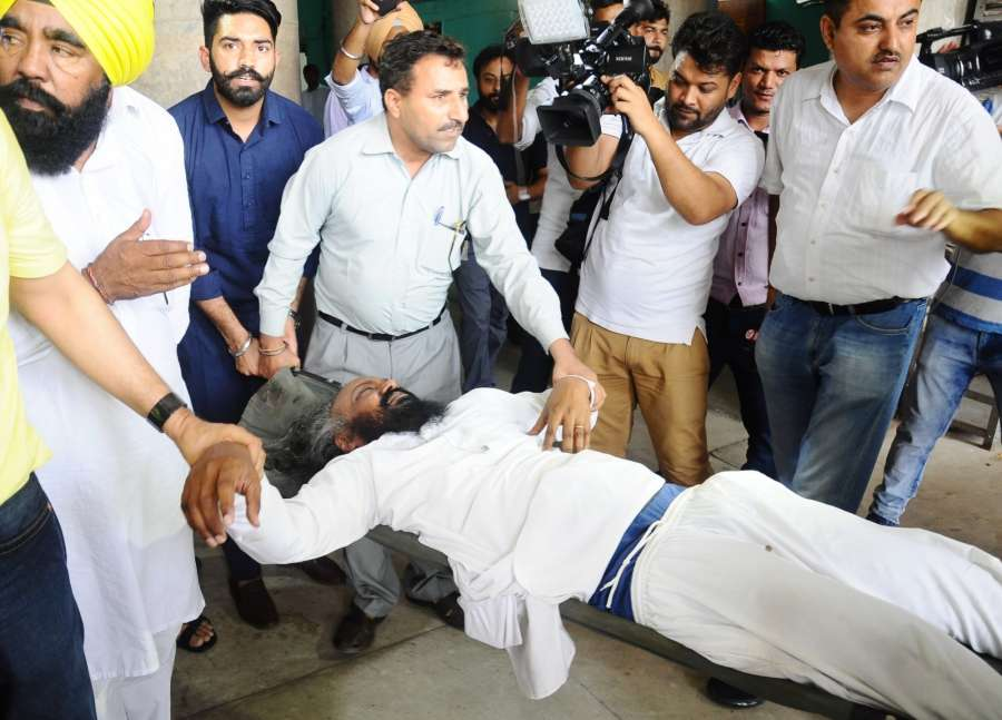 Chandigarh: AAP legislator Pirmal Singh Dhaula who alleged that his turban came off during manhandling by the marshalls after the Speaker ordered the removal of AAP lawmakers from the house in Chandigarh on June 22, 2017. (Photo: IANS) by .
