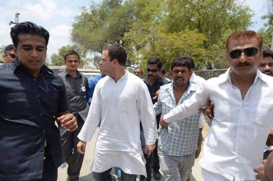 Neemuch: Congress vice president Rahul Gandhi being taken away by police when he tried to defy ban orders enforced in Madhya Pradesh's Mandsaur district where five protesting farmers were killed, in Neemuch district on June 8, 2017. (Photo: IANS) by .
