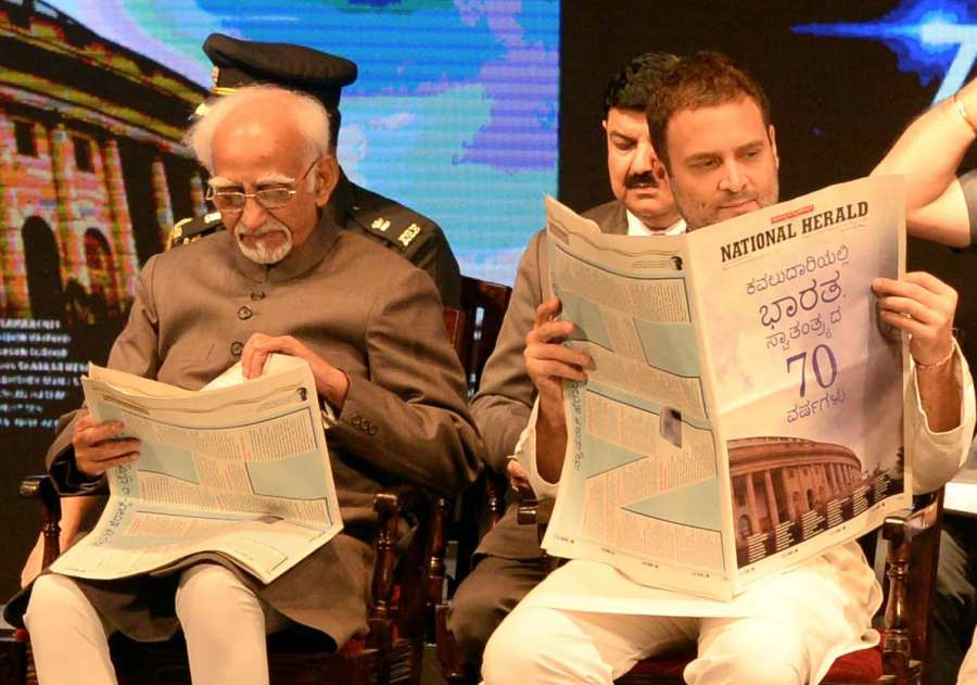 Bengaluru: Vice President Hamid Ansari and Congress Vice President Rahul Gandhi during the re-launch of National Herald news paper at Ambedkar Bhavan in Bengaluru on June 12, 2017. (Photo: IANS) by .