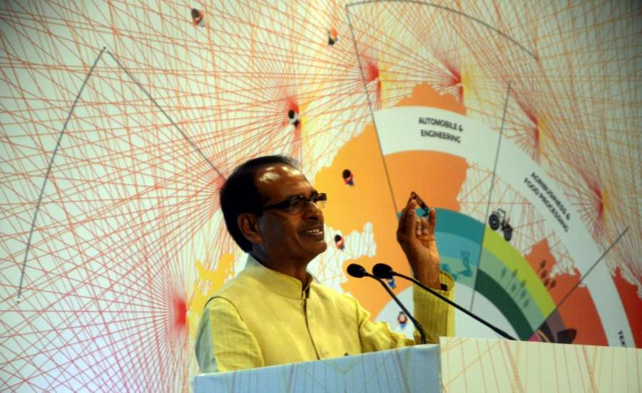 "Mumbai: Madhya Pradesh Chief Minister Shivraj Singh Chouhan addresses during a CII seminar on ""Investment Opportunities in Madhya Pradesh"" in Mumbai on Aug 12, 2016. (Photo: IANS) by ."