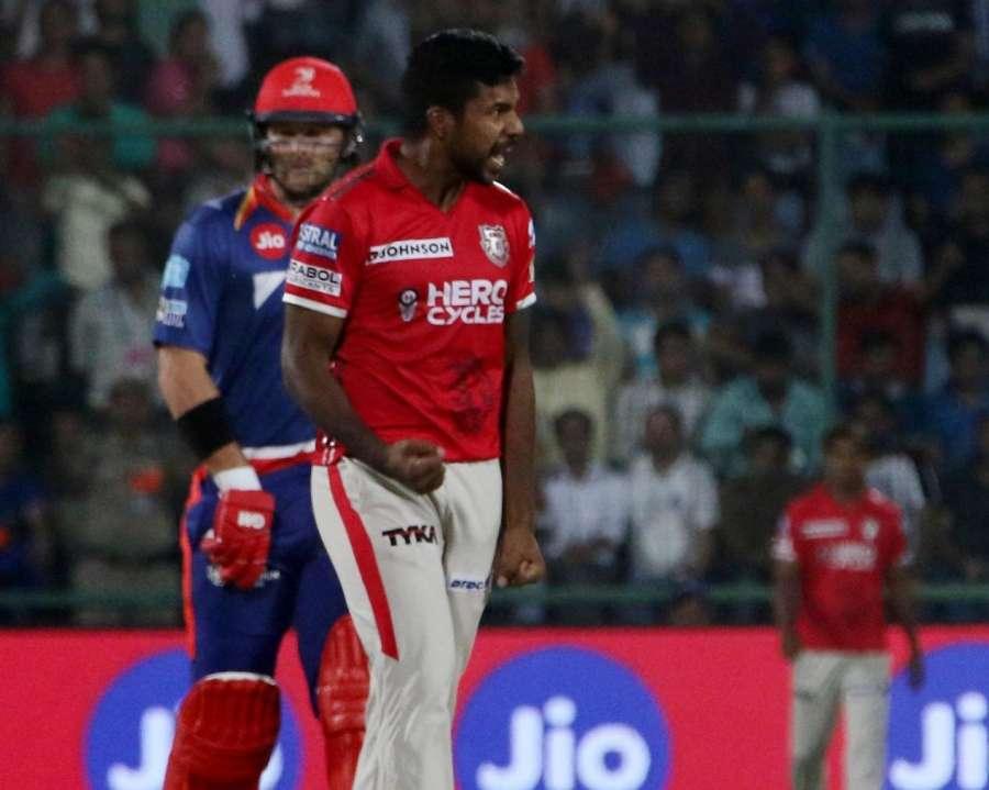 New Delhi: Kings XI Punjab player Varun Aaron celebrates fall of Risabh Pant's wicket during an IPL 2017 match between Delhi Daredevils and Kings XI Punjab at Feroz Shah Kotla in New Delhi on April 15, 2017. (Photo: Surjeet Yadav/IANS) by .