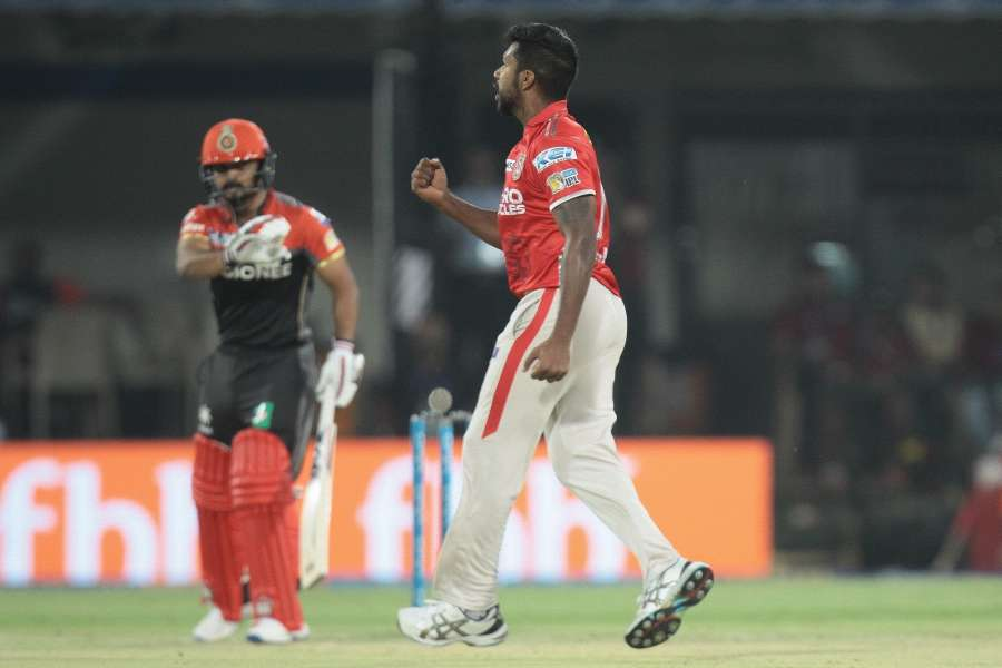 Indore: Varun Aaron of Kings XI Punjab celebrates fall of a wicket during an IPL 2017 match between Kings XI Punjab and Royal Challengers Bangalore at Holkar Cricket Stadium in Indore on April 10, 2017. (Photo: IANS) by .
